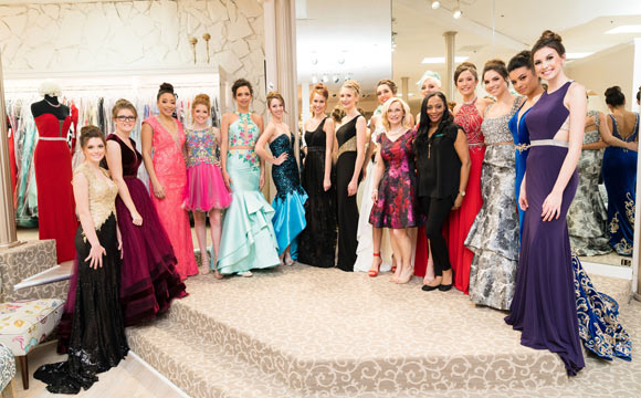 Group of girls in various prom dresses
