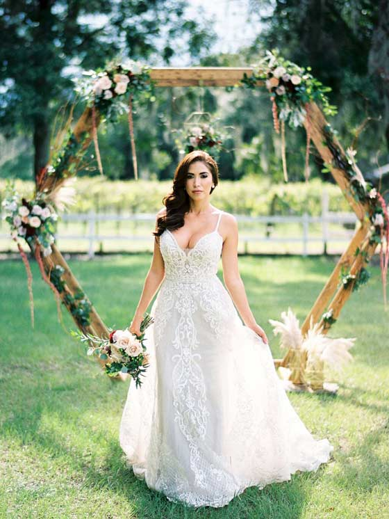 Bride Standing Outdoors Holding Flower